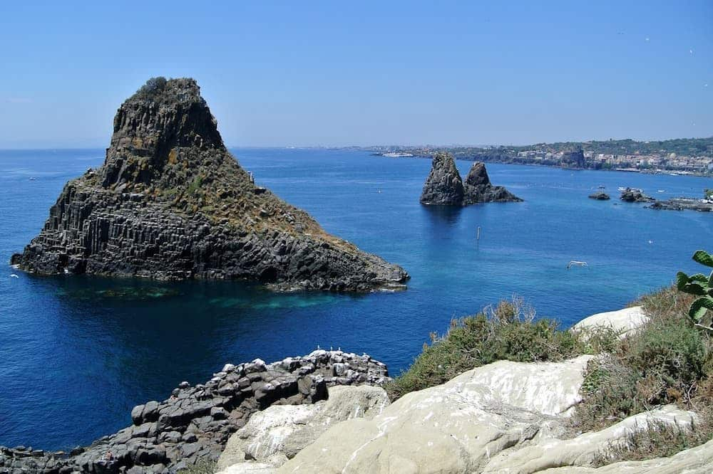 Boat excursion towards the sea stacks in Aci Castello and Acitrezza-image-4